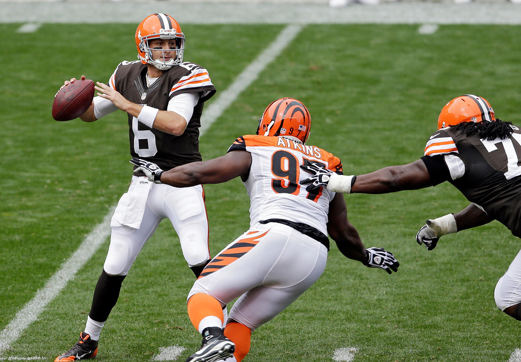 . Cleveland Browns quarterback Brian Hoyer (6) sets to pass under pressure from Cincinnati Bengals defensive tackle Geno Atkins (97) in the second quarter of an NFL football game on Sunday, Sept. 29, 2013, in Cleveland. (AP Photo/Tony Dejak)