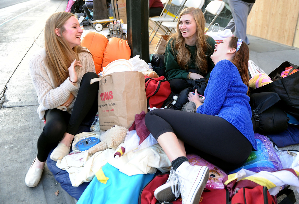 . Hope Freeman, left, along with Elle Kenwood, center, and Stephanie Beck of La Canada stake out their spots for the Rose Parade along Colorado Boulevard in Pasadena, Calif., on Tuesday, Dec. 29, 2013.     (Keith Birmingham Pasadena Star-News)