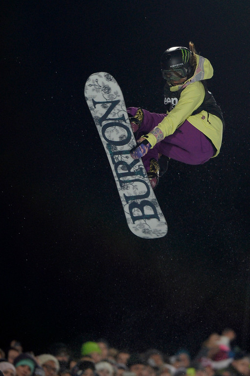 . Gold medalist Chloe Kim makes a grab during the women\'s snowboard half pipe final. Winter X Games on Saturday, January 24, 2015. (Photo by AAron Ontiveroz/The Denver Post)