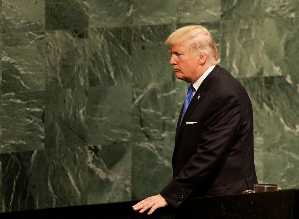. United States President Donald Trump leaves the podium after speaking during the United Nations General Assembly at U.N. headquarters, Tuesday, Sept. 19, 2017. (AP Photo/Seth Wenig)