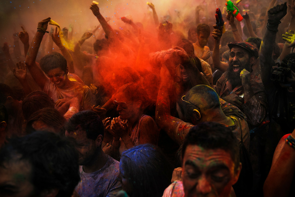 . Revelers of the Holi Festival of Colors throw colored powders in the air, in Madrid, Spain, Saturday, Aug. 9, 2014.  (AP Photo/Daniel Ochoa de Olza)