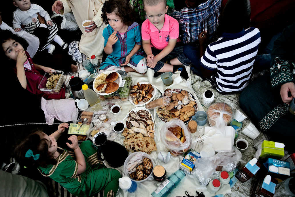 . Muslims in Denmark celebrate Eid al-Fitr in Valby, Copenhagen, Thursday, Aug. 8, 2013. Eid al-Fitr marks the end of the holy month of Ramadan, during which Muslims all over the world fast from sunrise to sunset. (AP Photo/POLFOTO, Joachim Adrian)