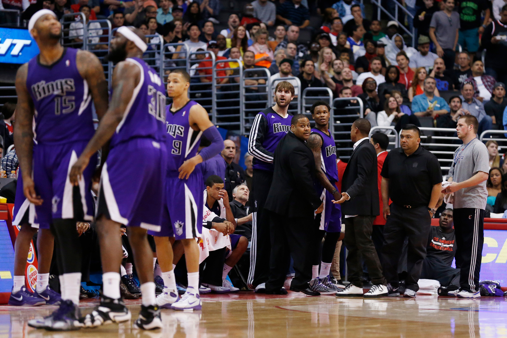 . Sacramento Kings guard Ben McLemore, fourth right, looks back from the edge of the court after being ejected for a technical foul on Los Angeles Clippers guard J.J. Redick during the second half of an NBA basketball game in Los Angeles, Saturday, April 12, 2014. The Clippers won 117-101. (AP Photo/Danny Moloshok)