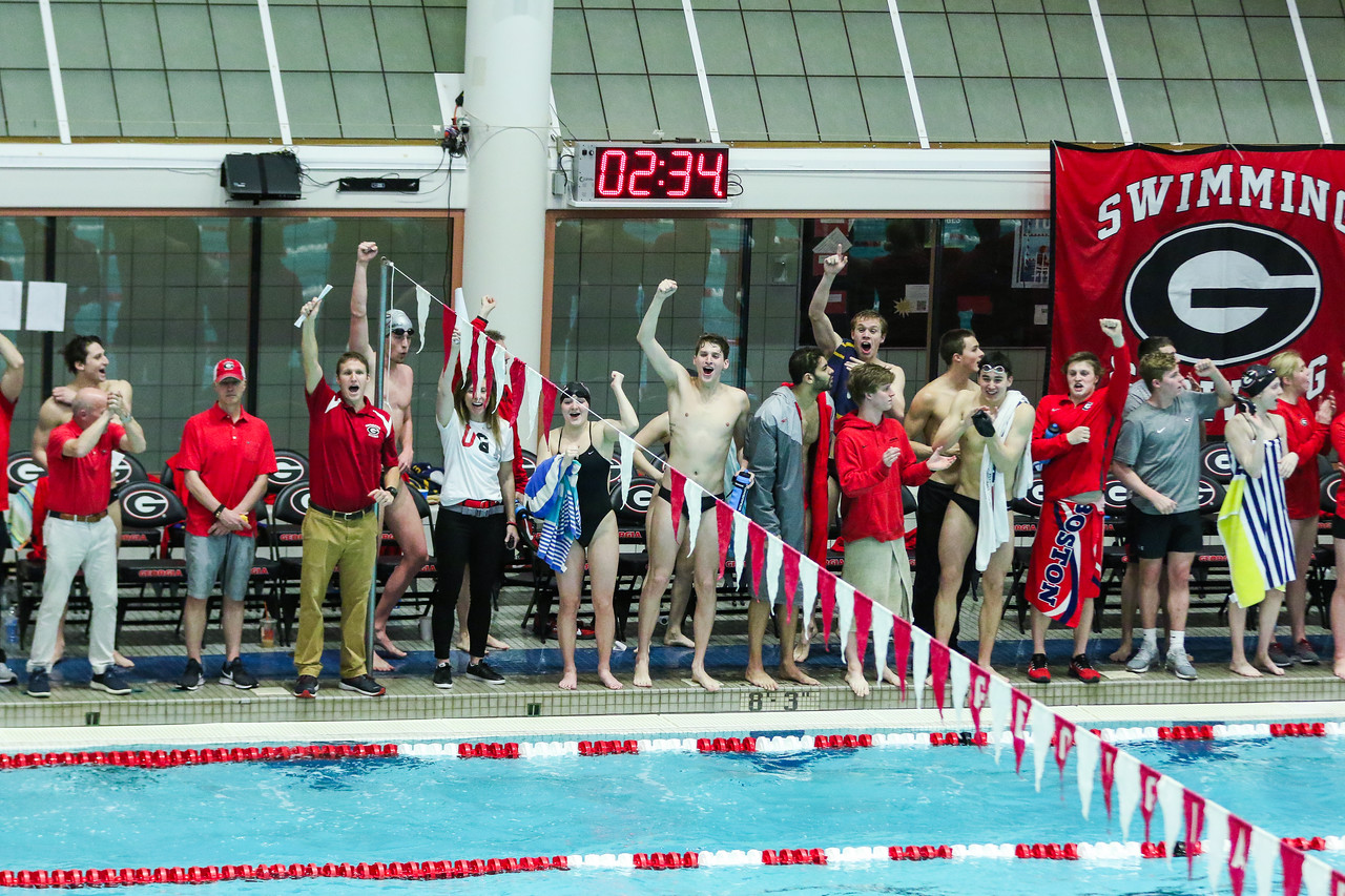 Georgia swimmers and coaches cheer during the swimming and diving meet at the Gabrielsen Natatorium in Athens, Ga., on Sat., Jan. 11, 2020. (Photo by Chamberlain Smith)