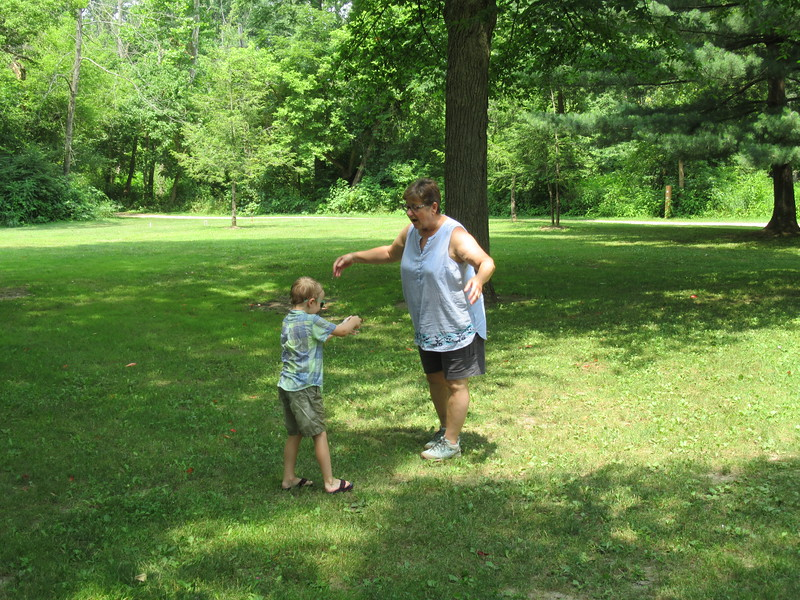 Ethan getting his grandma (Aunt Jane) wet with a water balloon.