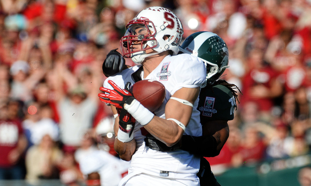 . Stanford wide receiver Michael Rector catches a 43 yard pass play for a first down against Michigan State in the first half of the 100th Rose bowl game in Pasadena, Calif., on Wednesday, Jan.1, 2014. 