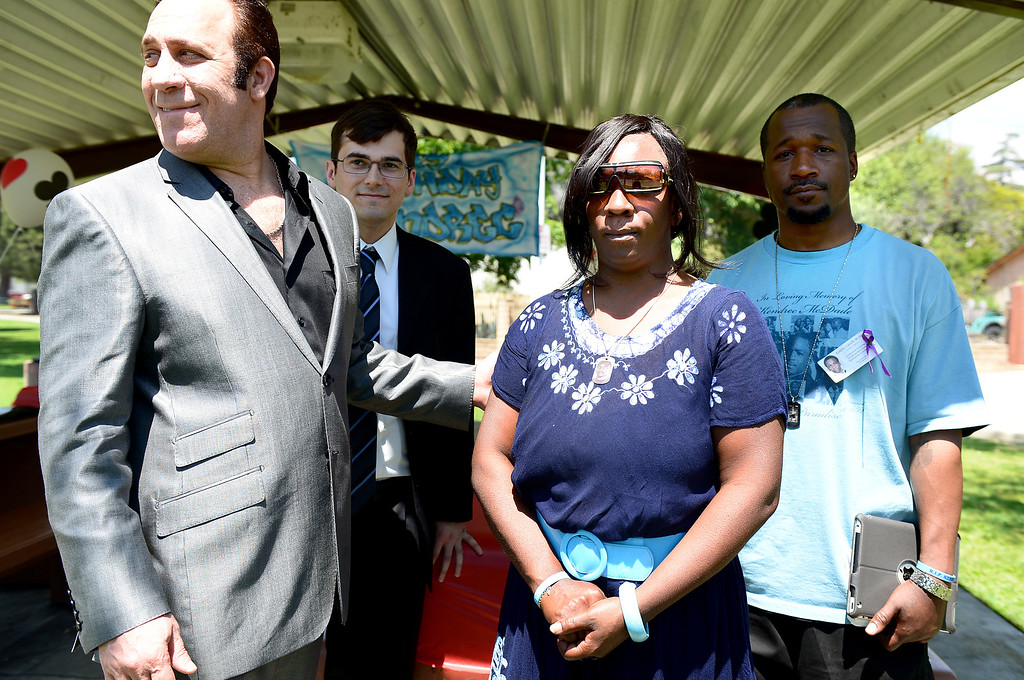 . With support of her attorney Dale Galipo, left, and brother Thomas McKeever, Anya Slaughter speaks to the press about her son Kendrec McDade as friends and family observe what would have been his 21st birthday at Northside Park in Azusa, Saturday, May 11, 2013. McDade, who was shot and killed by Pasadena police officers who claimed he was �reaching for his waistband� and was unarmed, would have turned 21 on May 5, 2013. March 24 will mark the year anniversary of his death. (SGVN/Staff Photo by Sarah Reingewirtz)