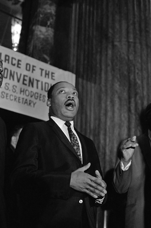 . FILE-This file photo shows the Rev. Martin Luther King Jr. joining in singing �We Shall Overcome� before he addressed the national convention of the Progressive National Baptist Convention in Cincinnati on Sept. 8, 1967. The 1.5 million-member Baptist group was founded in Cincinnati in 1961 by African-American church members seeking to create a religious movement that would support King�s civil rights advocacy. The Progressive Baptists are holding their week-long annual meeting in Detroit starting on Sunday, Aug. 4, 2013. (AP Photo/Harvey Eugene Smith)