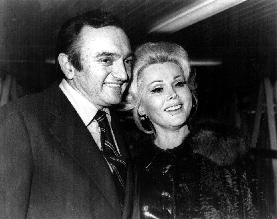 . Actress Zsa Zsa Gabor and her sixth husband Jack Ryan arrive at Heathrow airport in London, England on April 17, 1975.  (AP Photo)