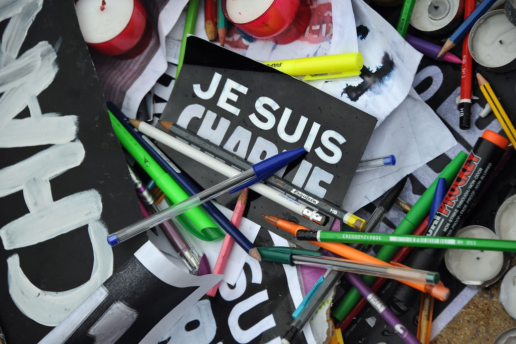 . A picture taken on January 8, 2015 shows pens and signs reading \'I am Charlie\'\' in La Rochelle during a gathering to pay tribute to the twelve people killed the day before in an attack by two armed gunmen on the offices of French satirical newspaper Charlie Hebdo in Paris. A huge manhunt for two brothers suspected of massacring 12 people in an Islamist attack at a satirical French weekly zeroed in on a northern town Thursday after the discovery of one of the getaway cars.  As thousands of police tightened their net, the country marked a rare national day of mourning for Wednesday\'s bloodbath at Charlie Hebdo magazine in Paris, the worst terrorist attack in France for half a century. AFP PHOTO / XAVIER  LEOTY/AFP/Getty Images