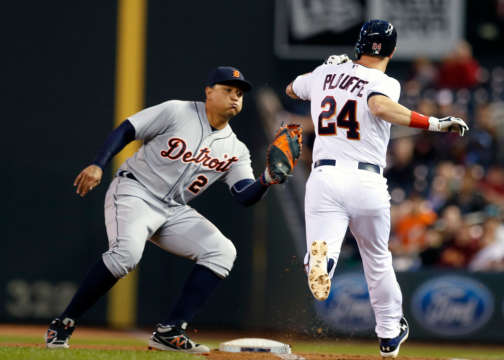 . Detroit Tigers first baseman Miguel Cabrera, left, reaches out to tag Minnesota Twins� Trevor Plouffe in the fourth inning of a baseball game, Monday, April 27, 2015, in Minneapolis. (AP Photo/Jim Mone)
