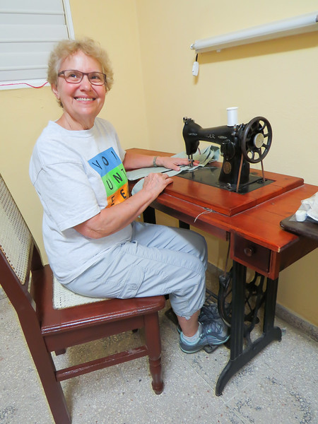 Judy at her treadle sewing machine.