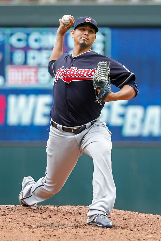 . Cleveland Indians starting pitcher Carlos Carrasco throws to the Minnesota Twins in the first inning of a baseball game Wednesday, Aug. 1, 2018, in Minneapolis. (AP Photo/Bruce Kluckhohn)