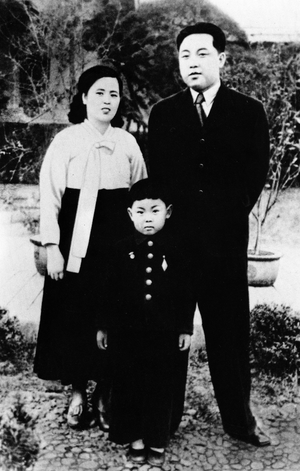 . In this undated photo from North Korea\'s official Korean Central News Agency, distributed by Korea News Service, Kim Jong Il (center) takes part of a souvenir picture during his childhood with his parents, Kim Jong Suk, right, and leader Kim Il Sung. (Korean Central News Agency/Korea News Service via AP Images)