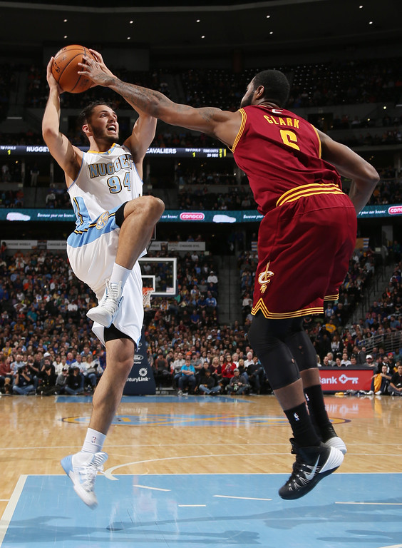 . Denver Nuggets guard Evan Fournier, left, of France, his his shot blocked by Cleveland Cavaliers forward Earl Clark in the fourth quarter of the Cavaliers\' 117-109 victory in an NBA basketball game in Denver on Friday, Jan. 17, 2014. (AP Photo/David Zalubowski)