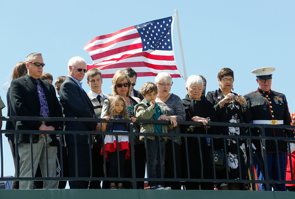 . Marlene Baisa, middle, the niece of Sgt. 1st Class Joseph Steinberg, and other family members watch as his remains are interred at Golden Gate National Cemetery in San Bruno, Calif., on Aug. 1, 2013. (John Green/Bay Area News Group)