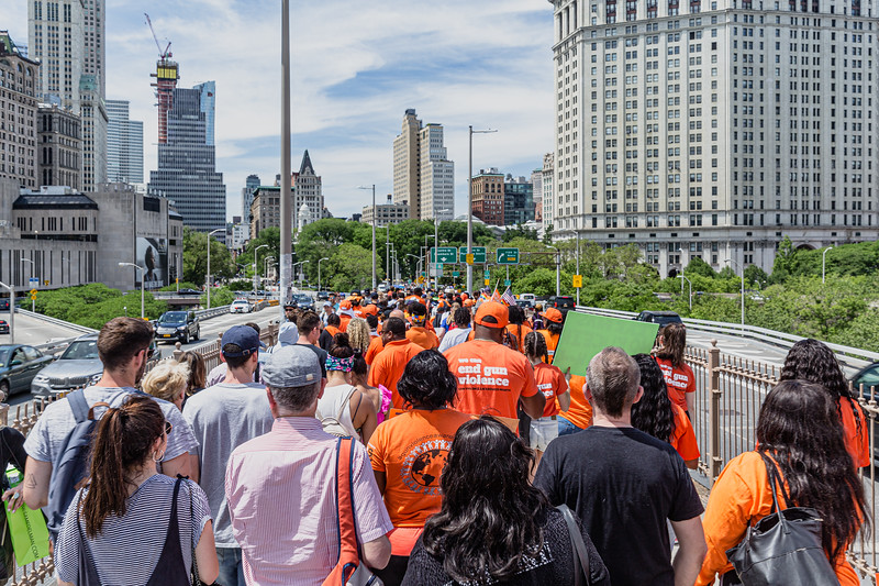 Wear Orange walk in solidarity with survivors across the Brooklyn Bridge, Jun 8, 2019.