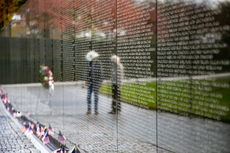 People visit the Vietnam Veterans Memorial on the National Mall in Washington, D.C.
