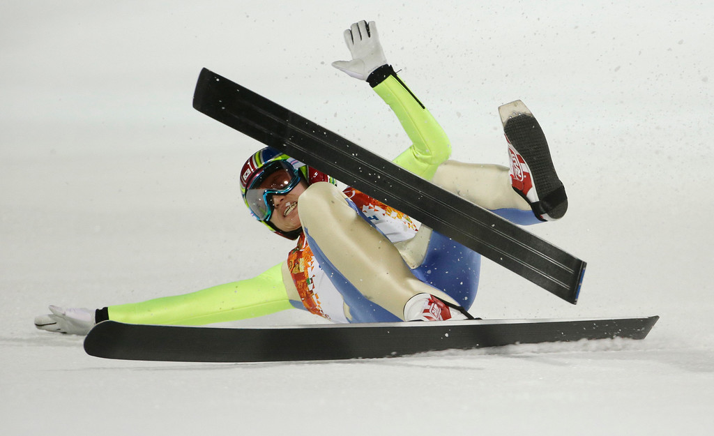 . South Korea\'s Choi Heung-chul stumbles after an attempt during the men\'s normal hill ski jumping qualification at the 2014 Winter Olympics, Saturday, Feb. 8, 2014, in Krasnaya Polyana, Russia. (AP Photo/Gregorio Borgia)