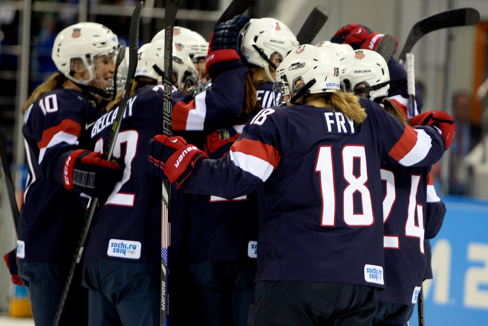 . Lyndsey Fry (18) celebrates with teammates after the third period of the United States\' 3-1 win against Finland. Sochi 2014 Winter Olympics on Saturday, February 8, 2014. (Photo by AAron Ontiveroz/The Denver Post)