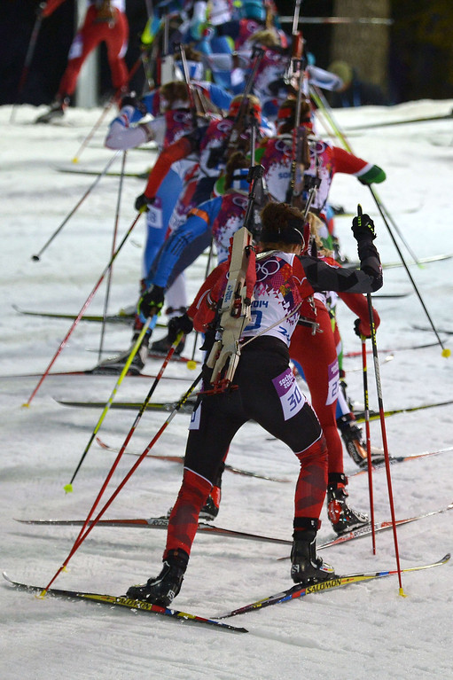 . Athletes compete in the Women\'s Biathlon 12,5 km Mass Start at the Laura Cross-Country Ski and Biathlon Center during the Sochi Winter Olympics on February 17, 2014, in Rosa Kuthor, near Sochi.  AFP PHOTO / ALBERTO PIZZOLI/AFP/Getty Images