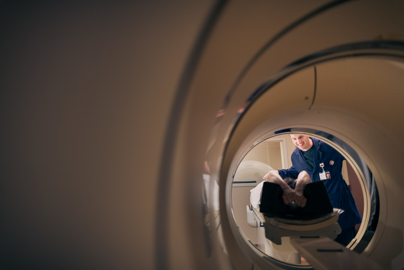 Looking Through MRI Scanner at Nurse and Patient