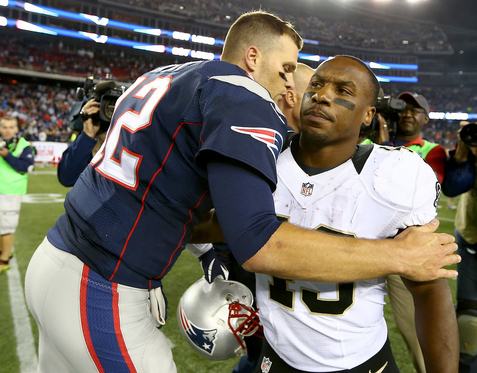 . Tom Brady #12 of the New England Patriots talks with Darren Sproles #43 of the New Orleans Saints after the game at Gillette Stadium on October 13, 2013 in Foxboro, Massachusetts.The New England Patriots defeated the New Orleans Saints 30-27.  (Photo by Elsa/Getty Images)
