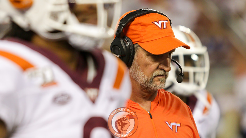 Defensive coordinator Bud Foster looks down as he walks off the field following a timeout. (Mark Umansky/TheKeyPlay.com)