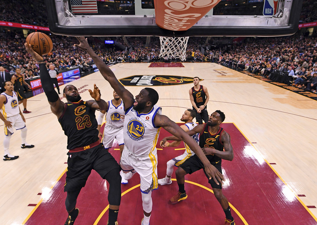 . Cleveland Cavaliers\' LeBron James shoots against Golden State Warriors\' Draymond Green during the first half of Game 4 of basketball\'s NBA Finals, Friday, June 8, 2018, in Cleveland. (Gregory Shamus/Pool Photo via AP)