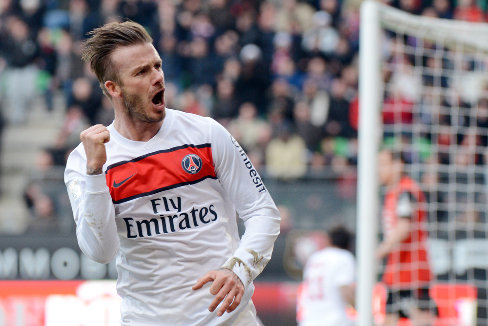 . In this file picture taken on April 6, 2013 Paris Saint-Germain\'s British midfielder David Beckham celebrates after making a decisive pass to teammate Swedish forward Zlatan Ibrahimovic allowing him to score during the French L1 football match Rennes vs Paris Saint-Germain at the Route de Lorient stadium in Rennes, western France.  David Beckham is set to retire from professional football at the end of the current season it was announced on May 16, 2013.  DAMIEN MEYER/AFP/Getty Images