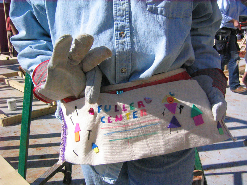08 03-10 One of the nail aprons decorated by Girl Scouts for all volunteers working on 3-house build. lcf