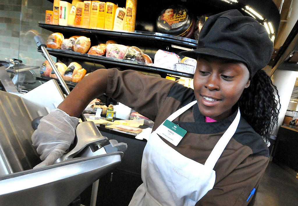 . Kandis Caston from Hopkins slices up specialty chicken lunch meat at the Lund\'s Store at 12th and Hennepin in Minneapolis.  (Pioneer Press: John Doman)