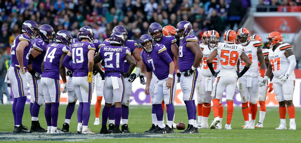 . Minnesota Vikings quarterback Case Keenum (7) huddles with his teammates during the first half of an NFL football game against Cleveland Browns at Twickenham Stadium in London, Sunday Oct. 29, 2017. (AP Photo/Matt Dunham)