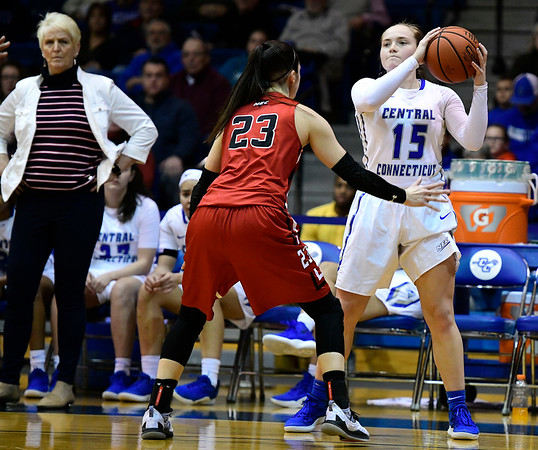 1/19/2019 Mike Orazzi | Staff CCSU's Emma McCamus (15) and Saint Francis University's Jess Kovatch (23) during Saturday's basketball game in New Britain.