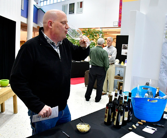 5/3/2019 Mike Orazzi | Staff Carl Johnson tastes a sample during the From the Vine wine tasting event at the Imagine Nation Museum Early Learning Center Friday evening.