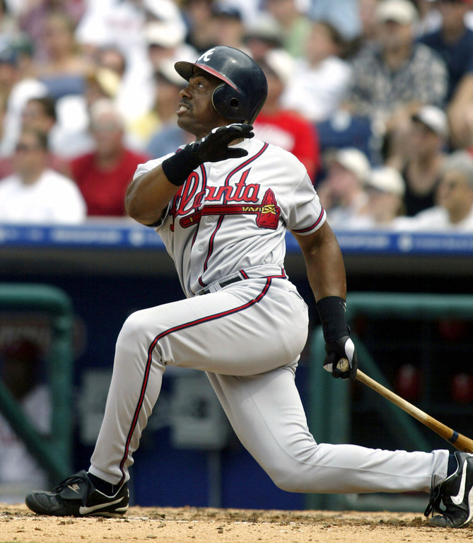 . JULIO FRANCO -- Atlanta Braves\' Julio Franco watches his three-run homer leave the park during the sixth inning against the Philadelphia Phillies on July 11, 2004, in Philadelphia.    (AP Photo/H. Rumph Jr.)