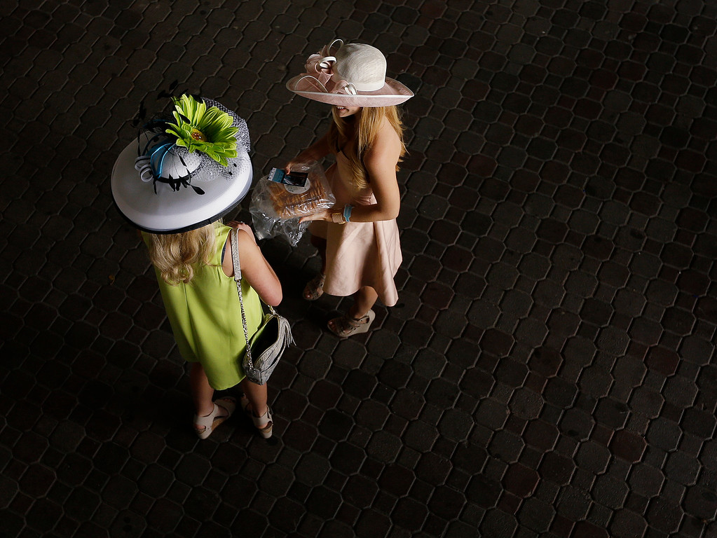 . Fans make their way to their seats before the 142nd running of the Kentucky Derby horse race at Churchill Downs Saturday, May 7, 2016, in Louisville, Ky. (AP Photo/David J. Phillip)