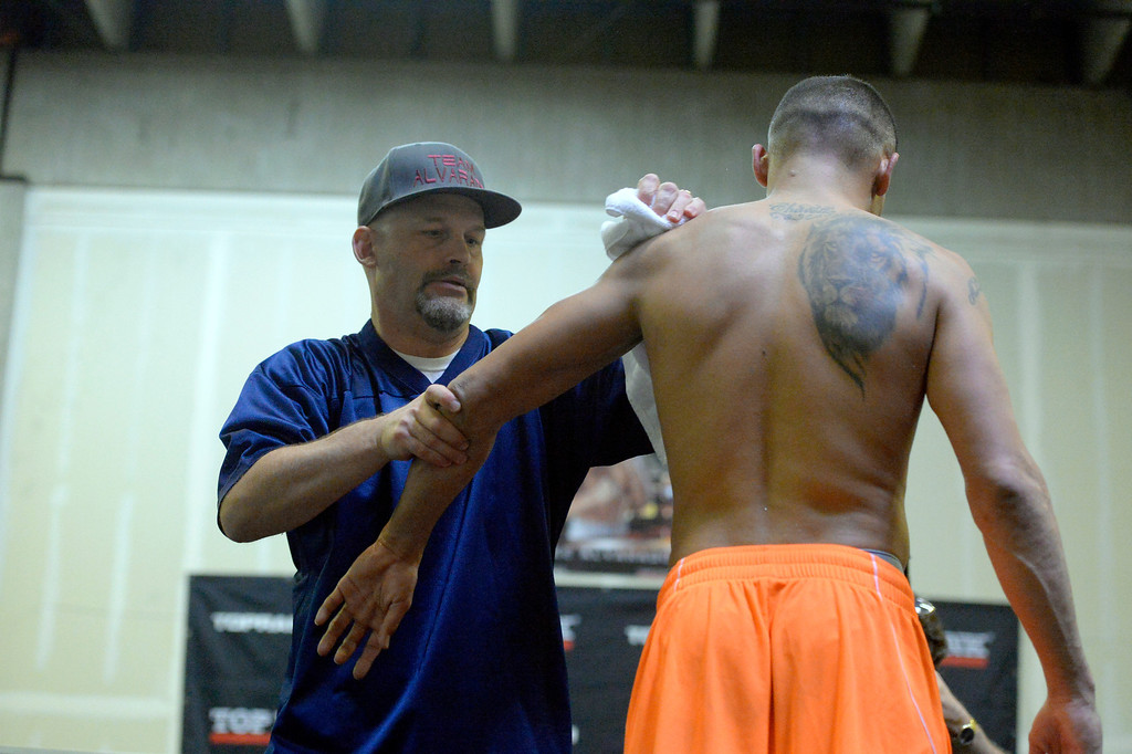 ". DENVER, CO - OCTOBER 15: Colorado\'s only reigning Champion ""Mile High\"" Mike Alvarado gets wiped down by Trainer Shann Vilhauer after his media workout day at Delgado\'s Gym October 15, 2013 as he gets ready for his fight with the Russian Provodnikov at 1st Bank Center. (Photo by John Leyba/The Denver Post)"
