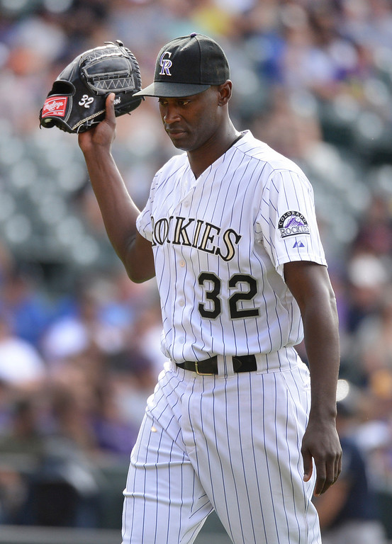 . DENVER, CO - JUNE 20: Colorado reliever LTroy Hawkins walked to the dugout after pitching the ninth inning. The Milwaukee Brewers defeated the Colorado Rockies 9-4 at Coors Field Saturday afternoon, June 21, 2014. Photo by Karl Gehring/The Denver Post