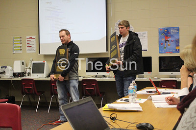 TV school board with Coach Nick Hemann and Cale Reicks