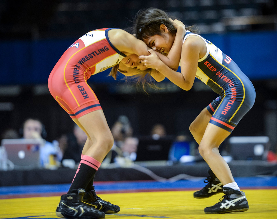 . Patricia Arana, 9, of Pacoima, red, and Viviana Garcia, 9, of San Fernando during their match at the USA vs Russia vs Canada dual meet at the Sports Arena Sunday .  Photo by David Crane/Los Angeles Daily News.