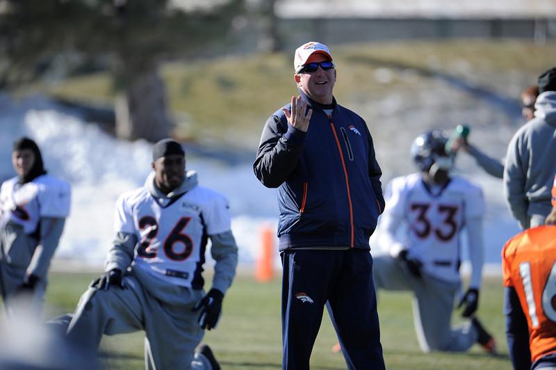 . Denver Broncos head coach John Fox walks among the players  during practice Thursday, December 20, 2012 at Dove Valley.  John Leyba, The Denver Post