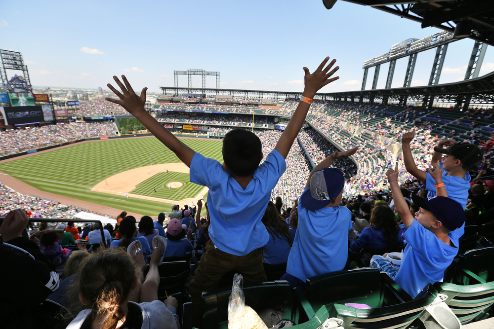 . Arapahoe Ridge Elementary students on a field trip celebrate a home run by the Colorado Rockies during a baseball game against the Atlanta Braves in Denver, Thursday, June 12, 2014. The Rockies won 10-3. (AP Photo/Brennan Linsley)