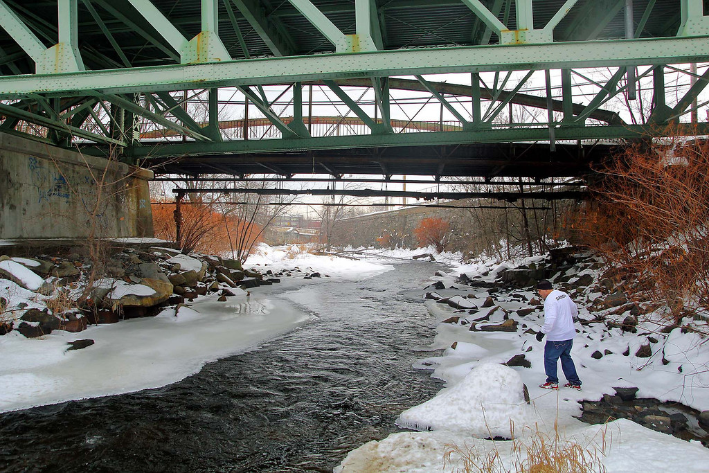 . Jose Oliver the father of the missing Fitchburg boy Jeremiah Oliver, 5, takes his search for Jeremiah on Saturday in Fitchburg down to the Nashua River under Rollstone Street. SENTINEL & ENTERPRISE/JOHN LOVE