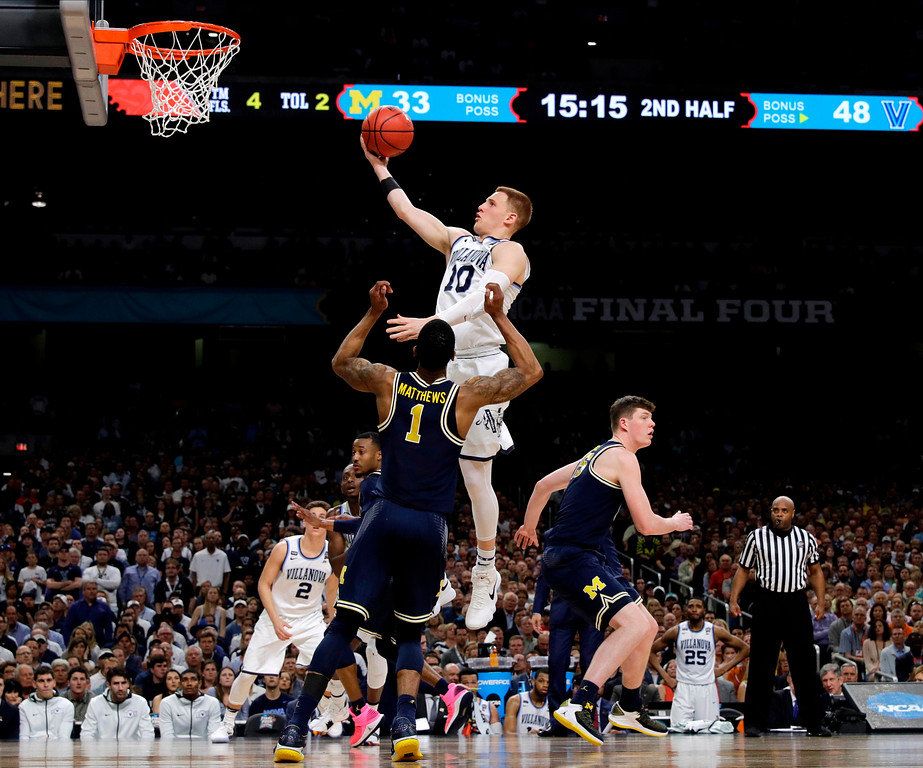 . Villanova guard Donte DiVincenzo drives to the basket over Michigan guard Charles Matthews (1) during the second half in the championship game of the Final Four NCAA college basketball tournament, Monday, April 2, 2018, in San Antonio. (AP Photo/David J. Phillip)