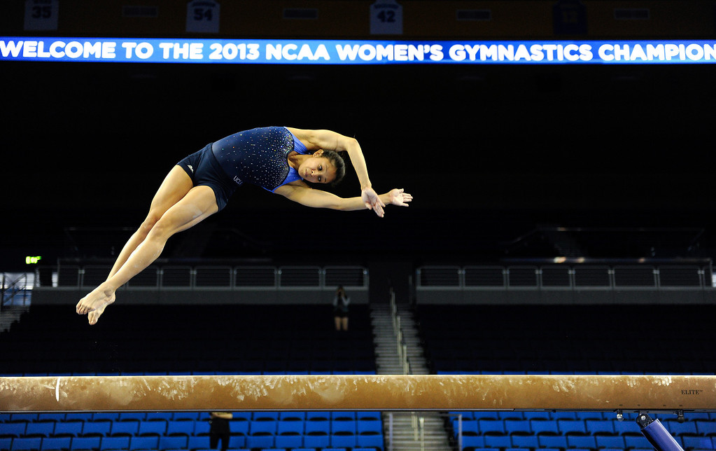 . UCLA Vanessa Zamarripa practices on the beam, Thursday, April 18, 2013, for the upcoming NCAA Women\'s Gymnastics Championships at Pauley Pavilion. (Michael Owen Baker/Staff Photographer)