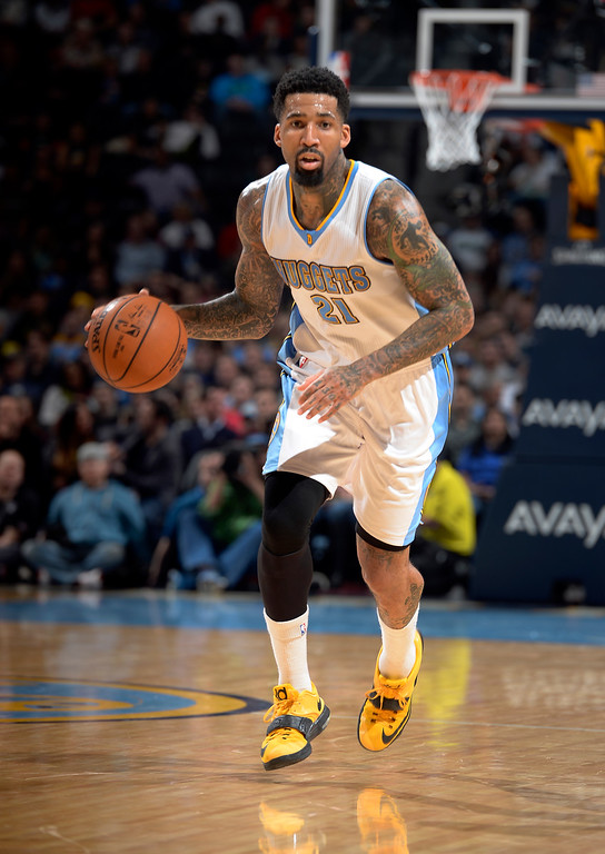 . DENVER, CO - JANUARY 14: Denver Nuggets forward Wilson Chandler (21) pushes the ball up court against the Dallas MavericksJanuary 14, 2015 at Pepsi Center. (Photo By John Leyba/The Denver Post)