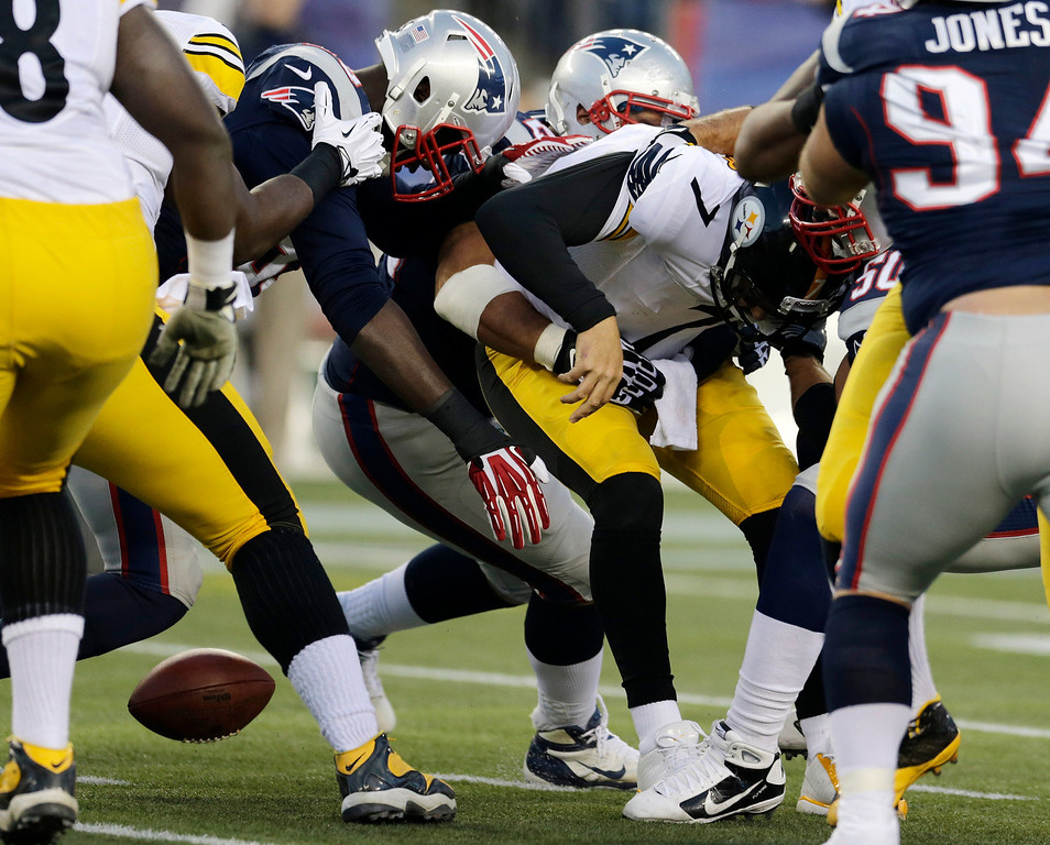 . New England Patriots defensive end Rob Ninkovich strips the ball from Pittsburgh Steelers quarterback Ben Roethlisberger (7) in the first quarter of an NFL football game Sunday, Nov. 3, 2013, in Foxborough, Mass. (AP Photo/Charles Krupa)
