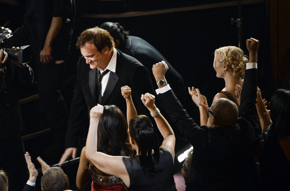 Description of . Writer/director Quentin Tarantino celebrates before he accepts the Best Writing - Original Screenplay award for