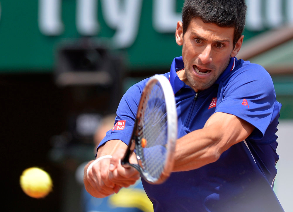 . Serbia\'s Novak Djokovic returns to Germany\'s Philipp Kohlschreiber during their French Tennis Open round of sixteen match at the Roland Garros stadium in Paris, on June 3,  2013. MIGUEL MEDINA/AFP/Getty Images